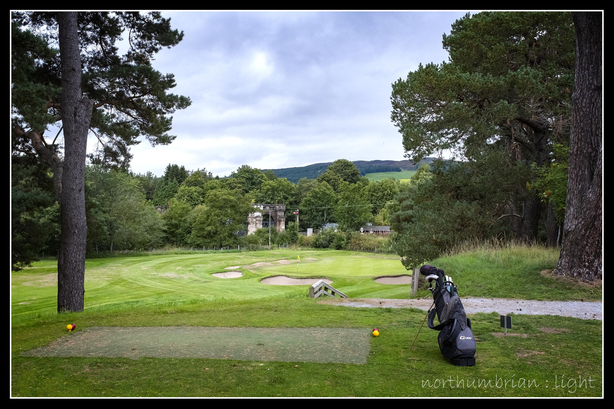 ... short par 3, Blair Atholl, with the castellated railway bridge over the River Garry in the background.
